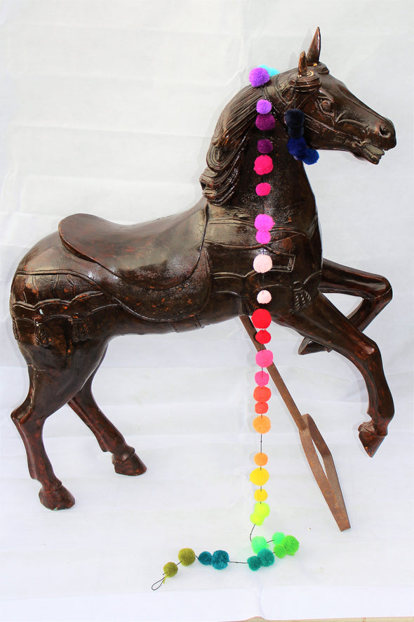 dark brown varnished carousel horse rearing up, with saddle and metal stand