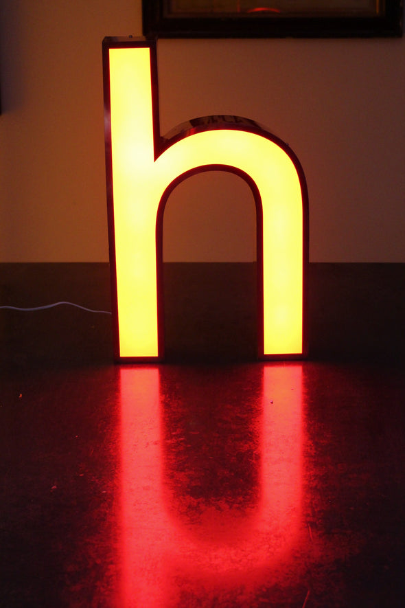 LIt letter h showing lovely red reflection and warm glow