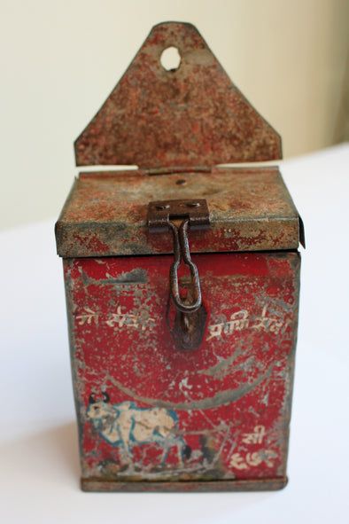 Beautifully aged Indian donation tin with red colouring, picture of sacred cow