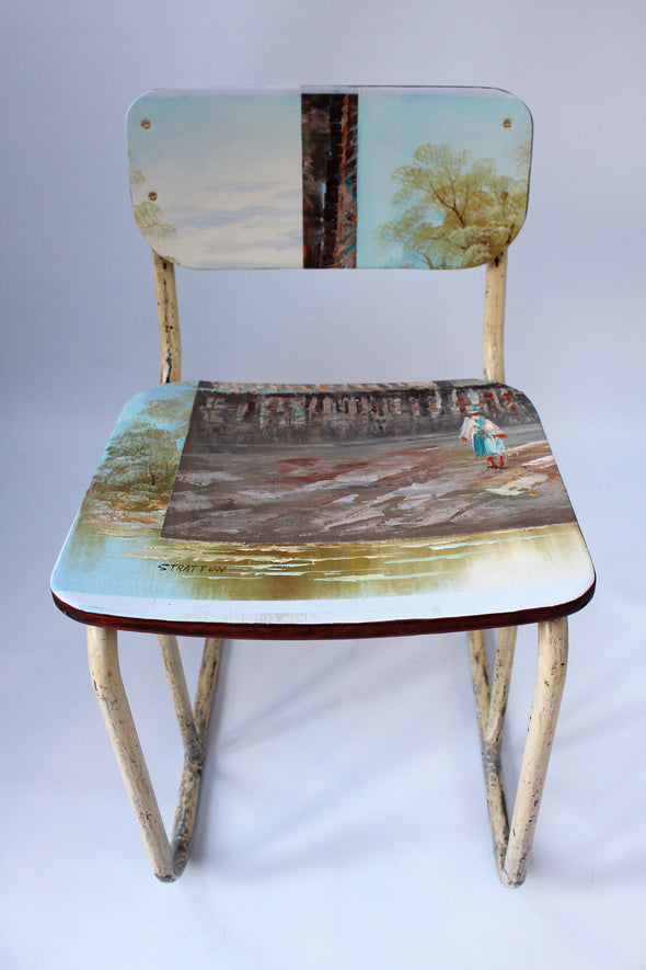 vintage industrial chair with interesting legs showing sky blue and warm brown colours from oil canvas painting on seat and back area