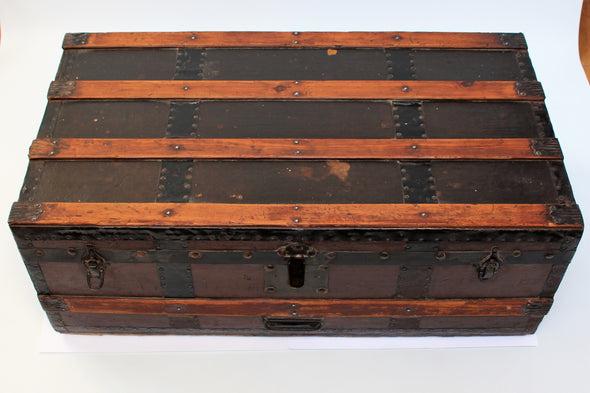 Victorian travel trunk with lovely aged wood panels in light brown running horizontally across, orginal lock and hinges in aged metal.