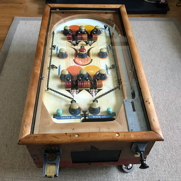 Pinball machine converted to Coffee table, displaying original levers and buttons, lovely orange blue colours