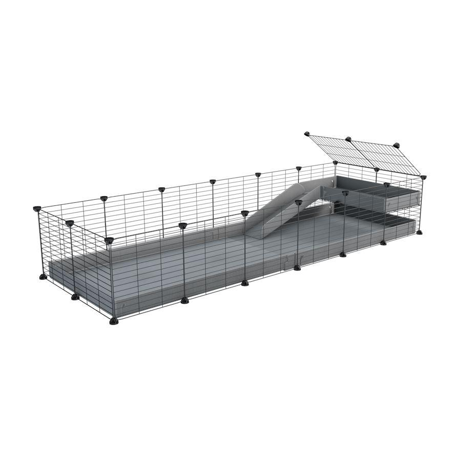 a 6x2 C&C guinea pig cage with a loft and a ramp grey coroplast sheet and baby bars by kavee