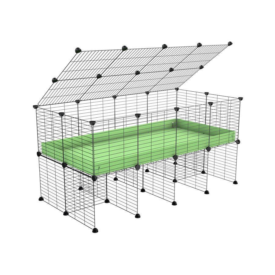 a 4x2 C&C cage for guinea pigs with a stand and a top green pastel pistacchio plastic safe grids by kavee