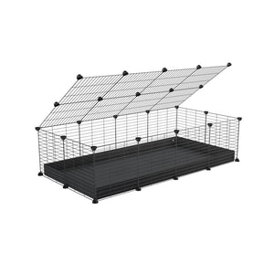 A 2x4 C and C cage for guinea pigs with black coroplast a lid and small hole grids from brand kavee