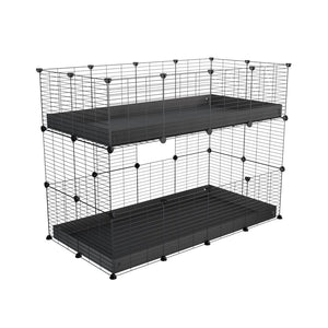 A 4x2 double stacked c and c guinea pig cage with two stories black coroplast safe size grids by brand kavee