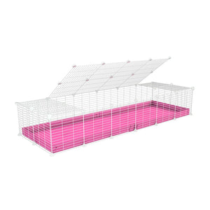A 2x6 C and C cage for guinea pigs with pink coroplast a lid and small hole white C&C grids from brand kavee