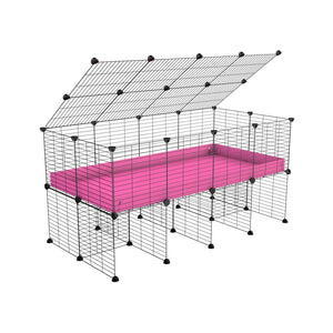 a 4x2 C&C cage for guinea pigs with a stand and a top pink plastic safe grids by kavee