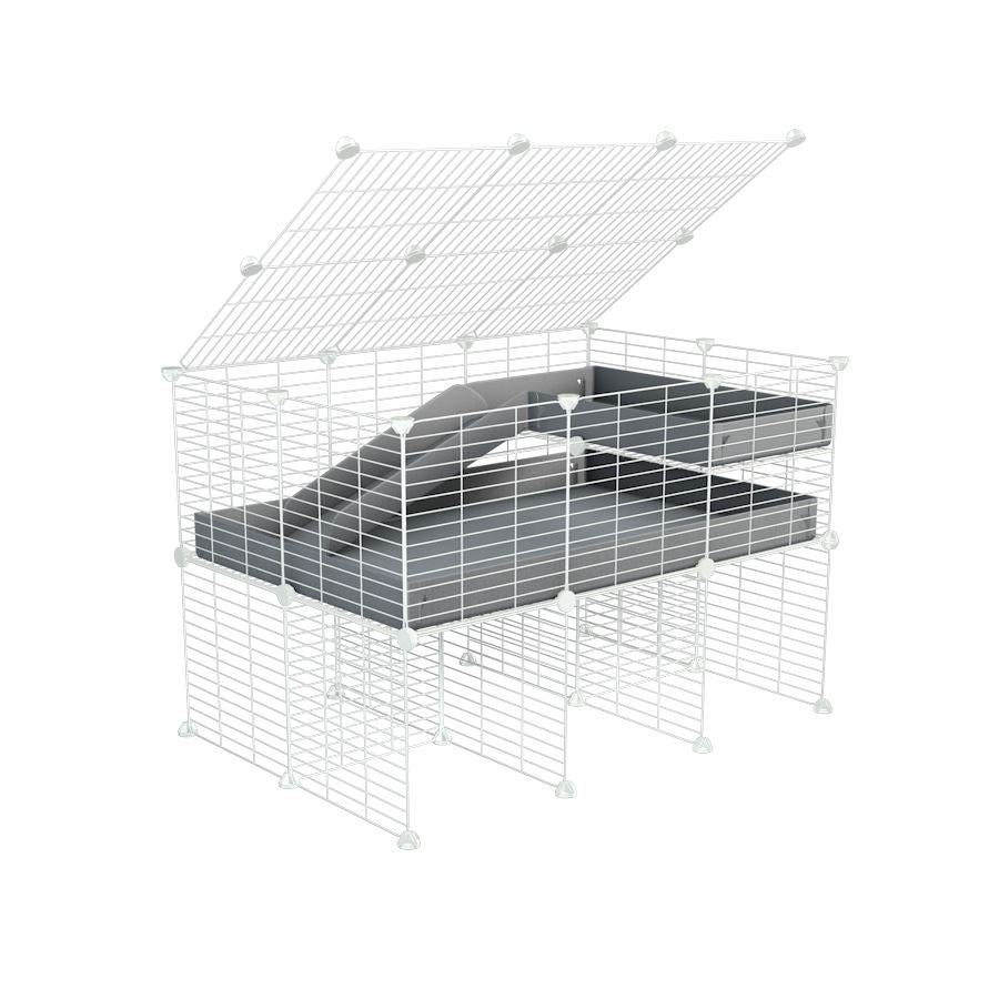 A 2x3 C and C guinea pig cage with stand loft ramp lid small size meshing safe white C and C grids grey correx sold in UK