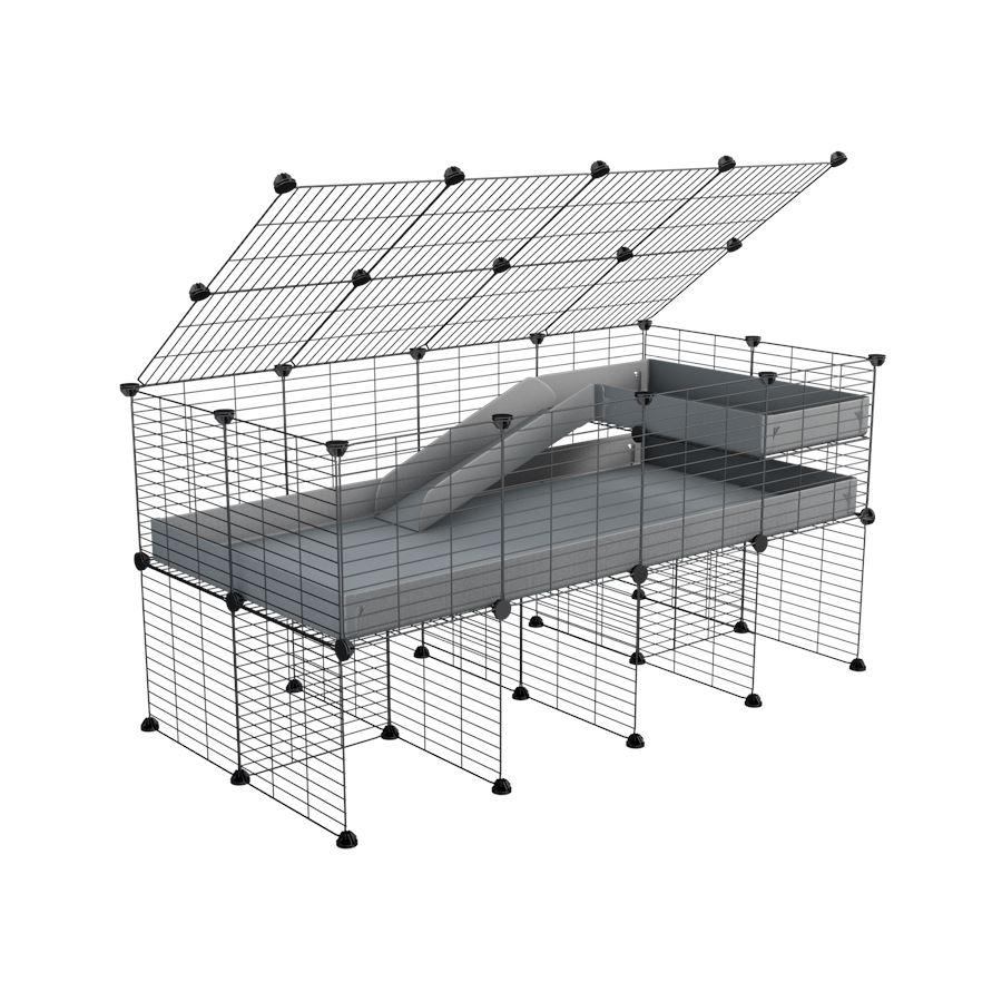 A 2x4 C and C guinea pig cage with stand loft ramp lid small size meshing safe grids grey correx sold in UK