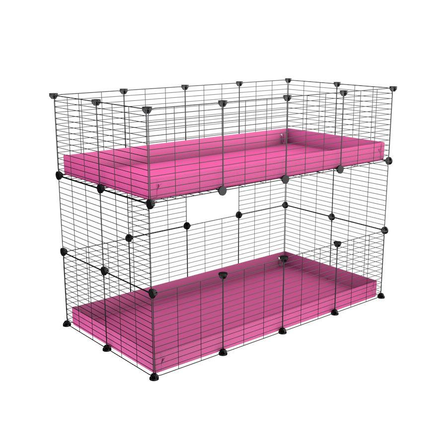 A 4x2 double stacked c and c guinea pig cage with two stories pink coroplast safe size grids by brand kavee