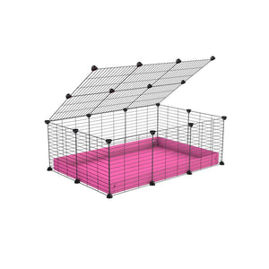 A 2x3 C and C cage for guinea pigs with pink coroplast a lid and small hole grids from brand kavee