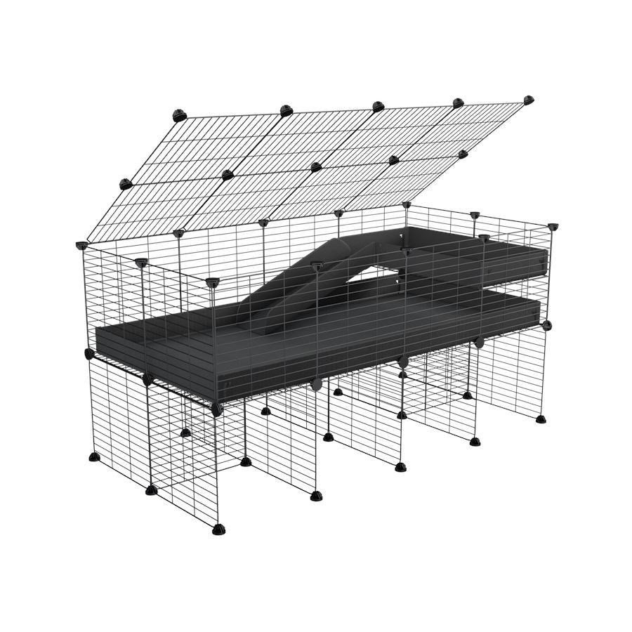 A 2x4 C and C guinea pig cage with stand loft ramp lid small size meshing safe grids black correx sold in UK
