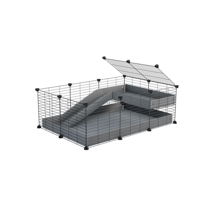 a 3x2 C&C guinea pig cage with a loft and a ramp grey coroplast sheet and baby bars by kavee