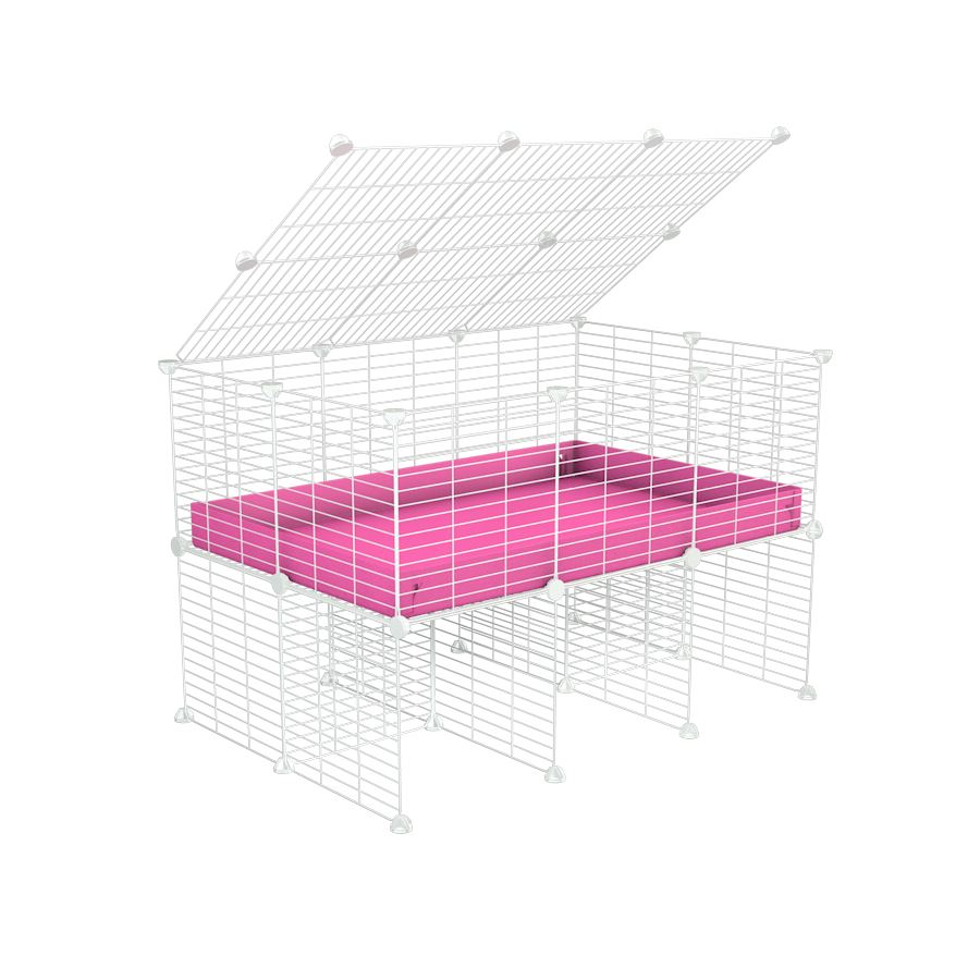 a 3x2 C&C cage for guinea pigs with a stand and a top pink plastic safe white grids by kavee