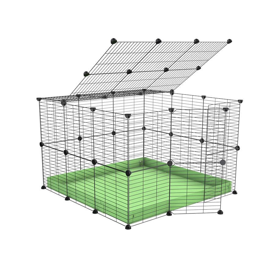 A 3x3 C and C rabbit cage with lid and safe baby grids green pastel coroplast by kavee UK