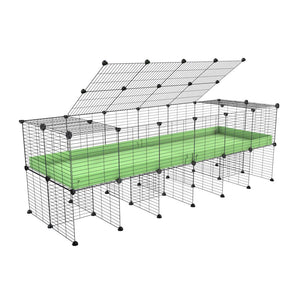 a 6x2 C&C cage for guinea pigs with a stand and a top green pastel pistachio plastic safe grids by kavee