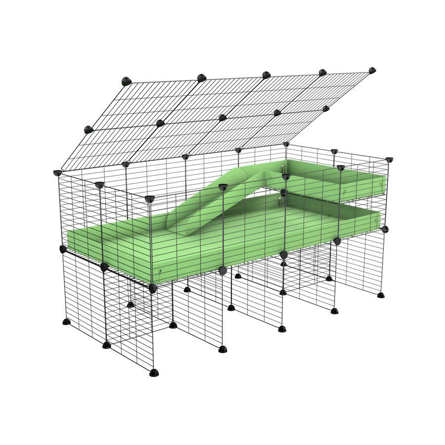 A 2x4 C and C guinea pig cage with stand loft ramp lid small size meshing safe grids green pastel pistachio correx sold in UK