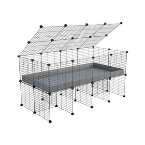 a 4x2 C&C cage for guinea pigs with a stand and a top grey plastic safe grids by kavee
