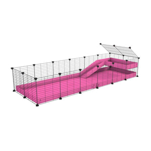 a 6x2 C&C guinea pig cage with a loft and a ramp pink coroplast sheet and baby bars by kavee