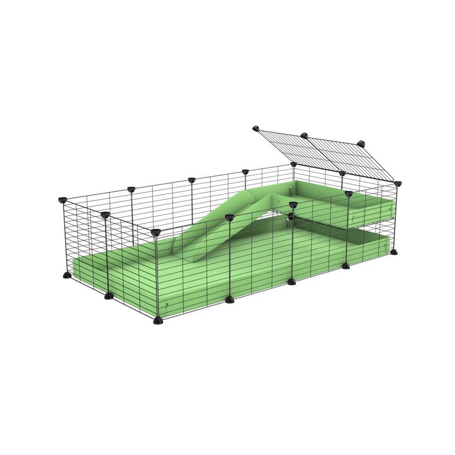 a 4x2 C&C guinea pig cage with a loft and a ramp green pastel pistacchio coroplast sheet and baby bars by kavee