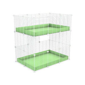 A two tier 3x2 c&c cage for guinea pigs with two levels green pastel correx baby safe white grids by brand kavee in the uk
