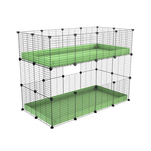 A 4x2 double stacked c and c guinea pig cage with two stories pistachio green coroplast safe size grids by brand kavee
