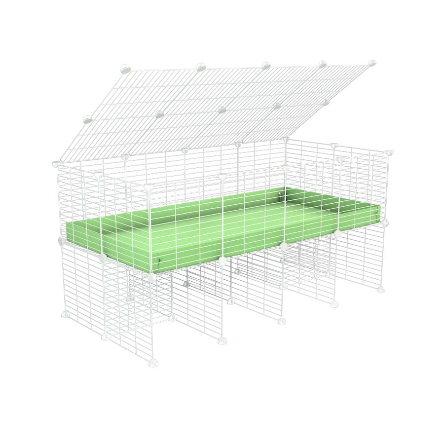 a 4x2 C&C cage for guinea pigs with a stand and a top green pastel pistacchio plastic safe white C&C grids by kavee