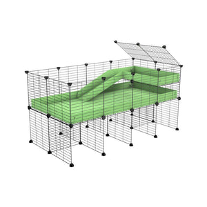 a 4x2 CC guinea pig cage with stand loft ramp small mesh grids green pastel pistachio corroplast by brand kavee