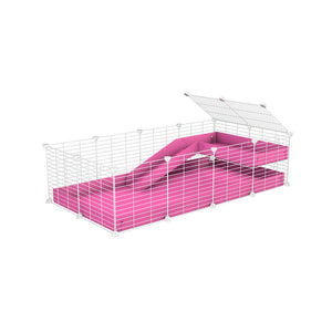 a 4x2 C&C guinea pig cage with a loft and a ramp pink coroplast sheet and baby bars by kavee