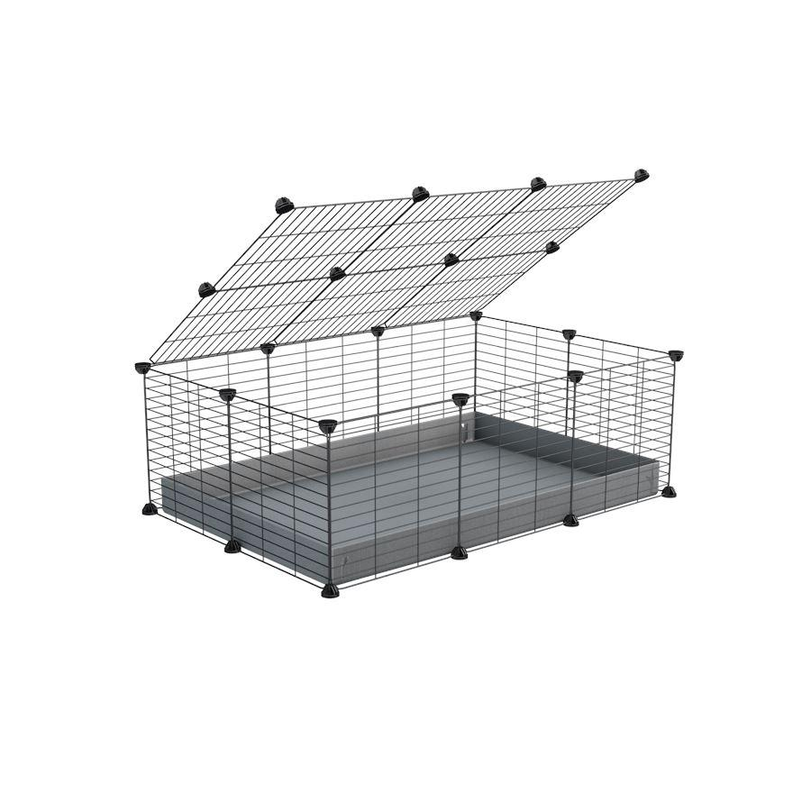 A 2x3 C and C cage for guinea pigs with grey coroplast a lid and small hole grids from brand kavee