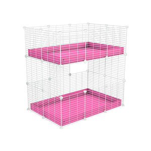 A two tier 3x2 c&c cage for guinea pigs with two levels pink correx baby safe white grids by brand kavee in the uk