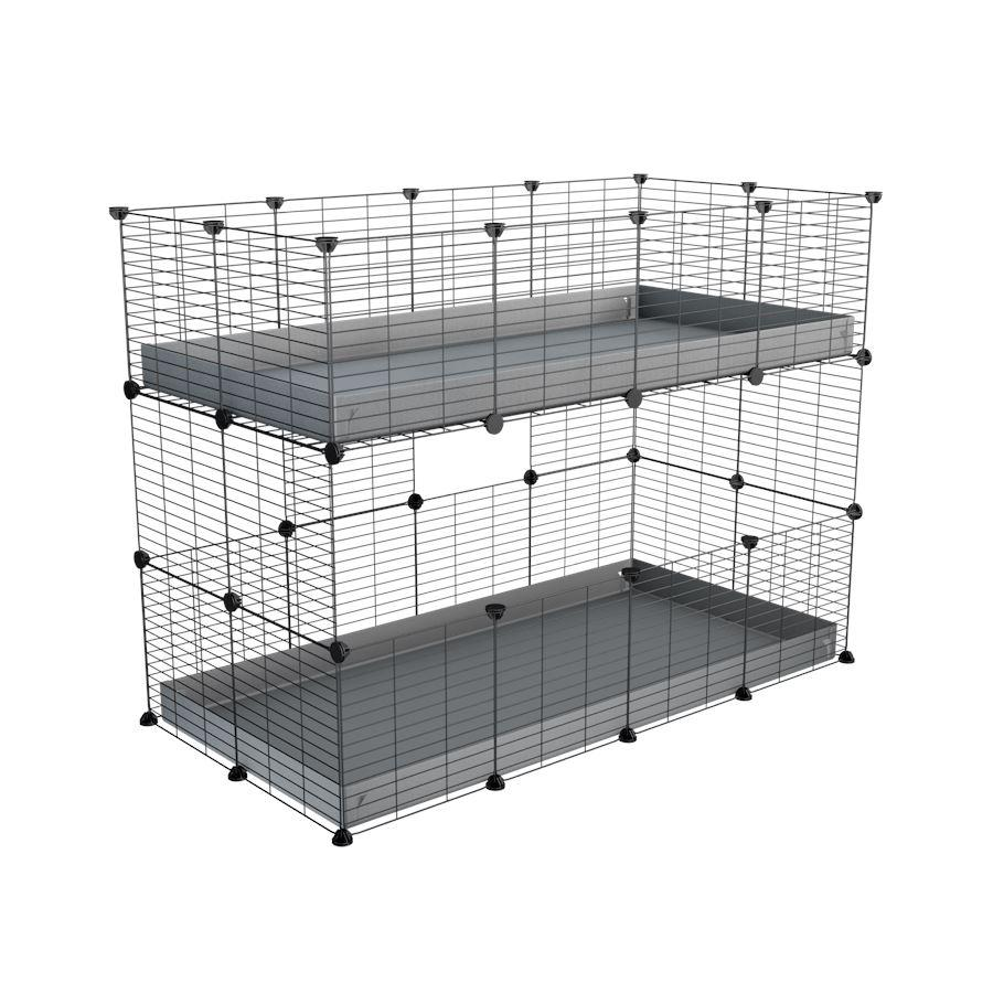 A 4x2 double stacked c and c guinea pig cage with two stories grey coroplast safe size grids by brand kavee