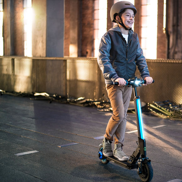 Boy riding blue Jetson Beam Electric scooter