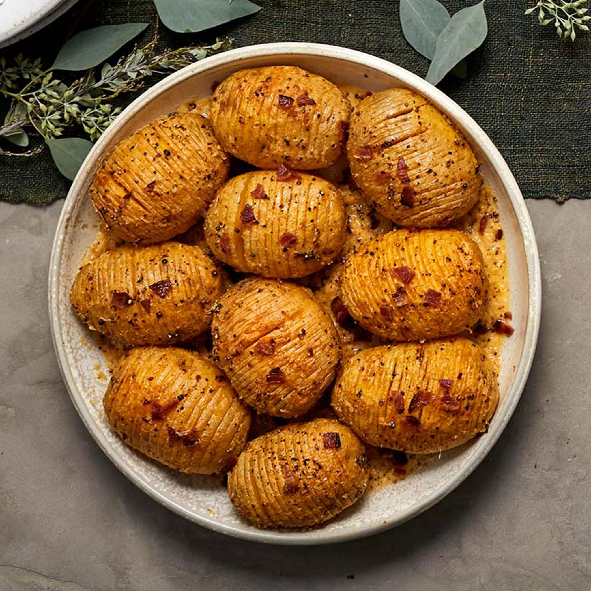 Hasselback Potatoes and Applewood Bacon Gratin