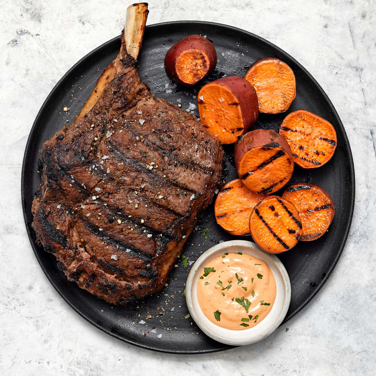 Prime Black Angus Bone-In Beef Cowboy Steak - Dusted Cowboy Ribeye Steak with Chipotle Crema and Grilled Sweet Potatoes