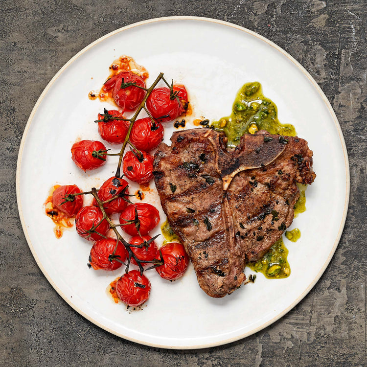 Bone-In Veal Loin Chops - Grilled Veal Loin Chops with Pistachio-Basil Pesto and Charred Tomatoes