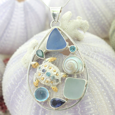 Exquisite Silver Medallion features a collage of sea life- a silver sea turtle,  genuine sea glass & and sea shell and a medley of gemstones