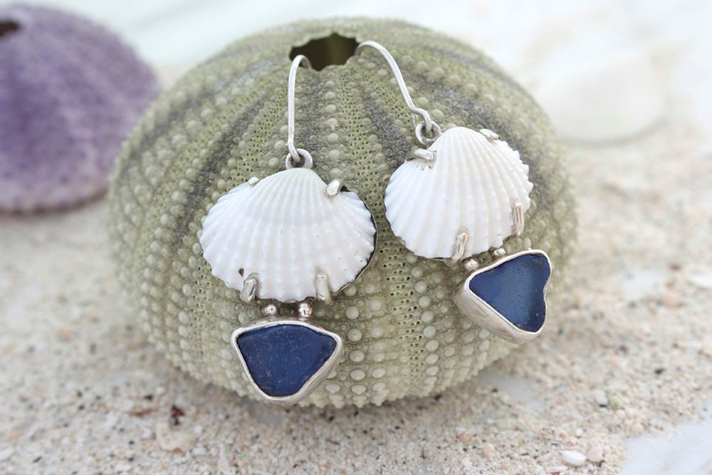 Sea Shell has a heart of Cobalt Blue !! This Sea glass earring is a Must Have!!