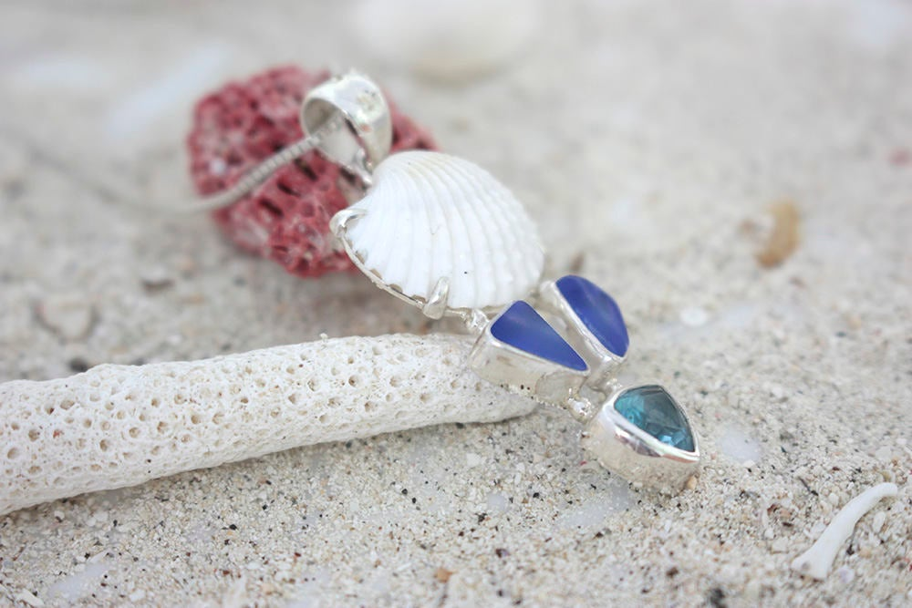 Bring Home the beach with this Genuine Sea Shell and Cobalt Blue Sea glass pendant! .this is a must have!!  It is The perfect beach gift!