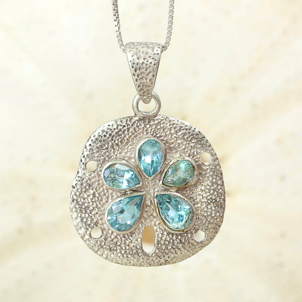 Sand Dollar Pendant handcrafted in sterling silver encrusted with BlueTopaz Gemstones