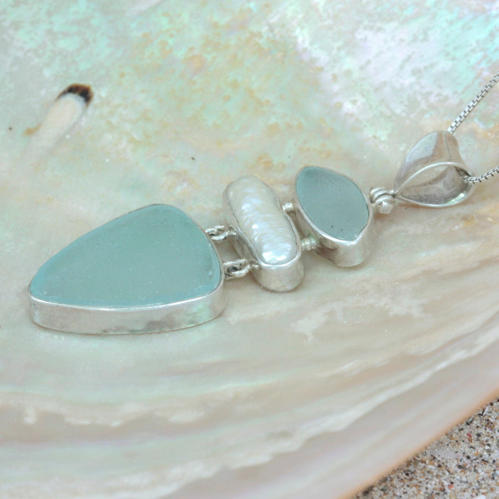 Bring home the beach with this Exquisite Aqua Sea Glass Pendant!