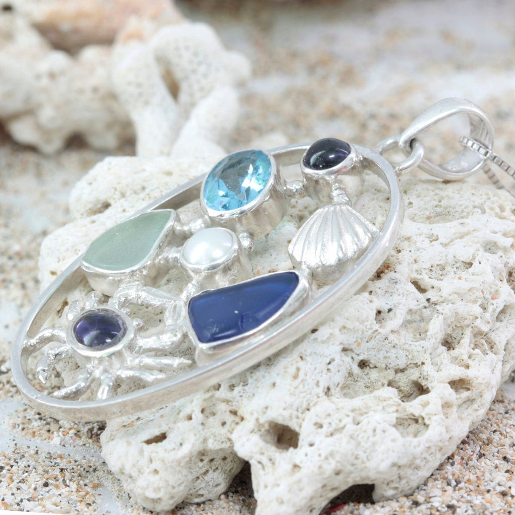 Silver Sea Life Pendant- a story of a little crab wearing a blue sweater, playing with a sea shell ,a pearl & 2 pieces of sea glass