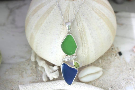 Sea Glass Story- This Geometric Silver Pendant unites blue & green sea glass with a touch of peridot!