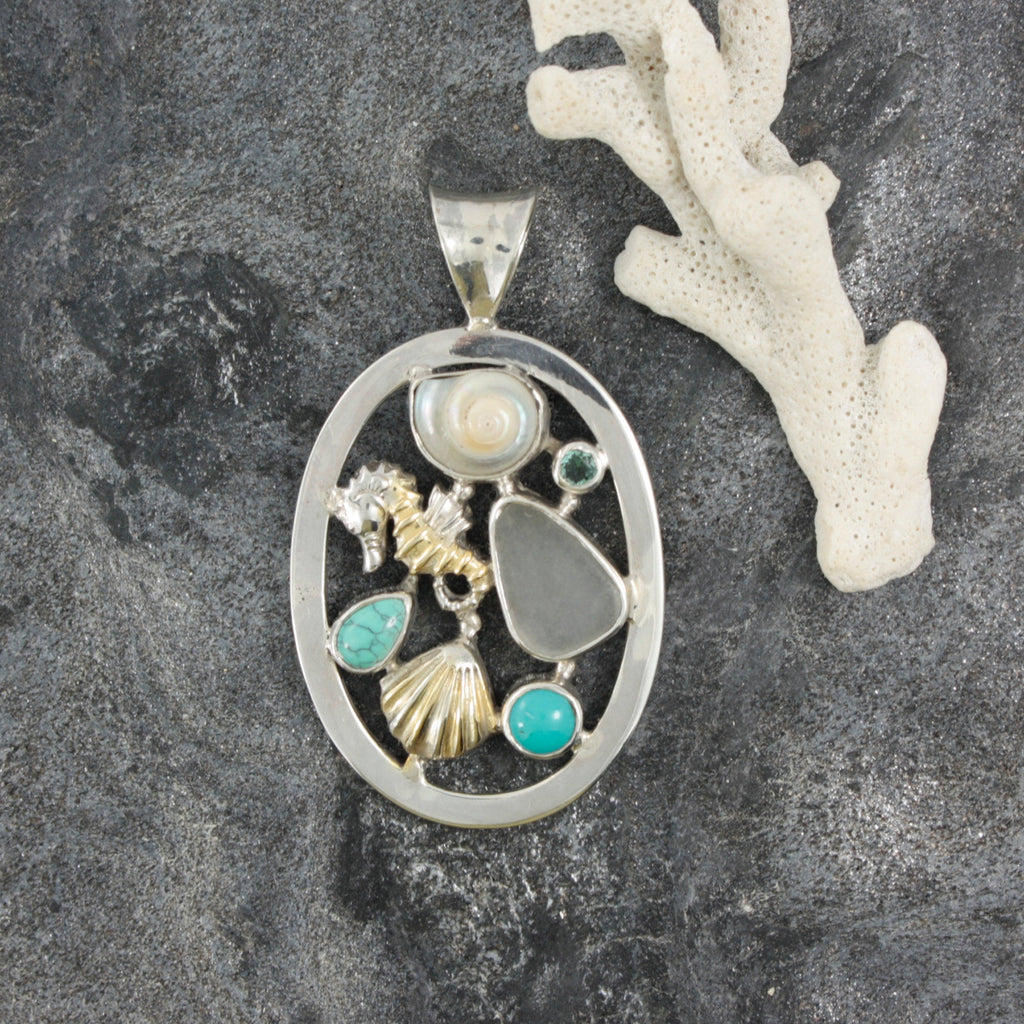 Sealife Medallion Pendant A true  Sea life Story! Unusual mix of Sea shell Sea glass and Gemstones set into an oval frame of sterling Silver