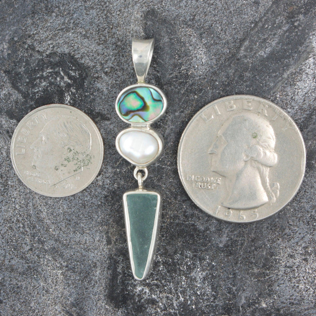 Bring home a piece of the beach with this PAUA Shell,Keshie pearl and Genuine Aqua Sea Glass Pendant!