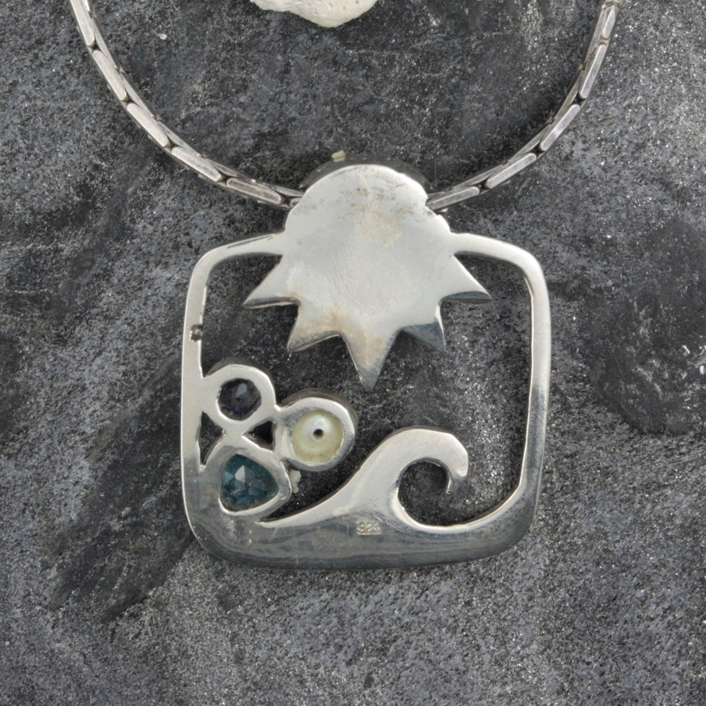 Bring home the ocean with this Sun and Wave pendant