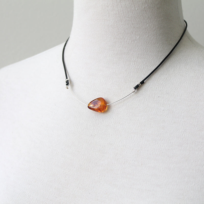 Amber and leather necklace in silver