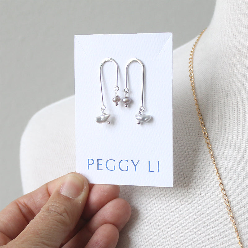Asymmetrical earrings with pearl