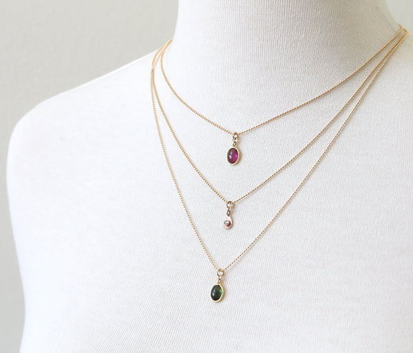 Delicate gemstone necklaces, layered